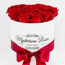 Virágposta - Vörös rózsák Mysterious hengerdobozban